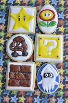 Star, fire flower, goomba, mystery/question block, brick block, and blooper cookies from the Super Mario Bros themed cookies for a friend's 8th birthday.
