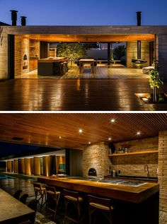 This kitchen has a built-in fire oven and large island with cooktop and seating. There's also a dining area and a small space to sit by the hanging fireplace. Modern Architecture Design, Modern House Design, Modern Outdoor Kitchen, Casas Containers, Villa, Layout Design, Design Ideas, Future House, Patio