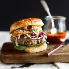 Asian-Style Pork Burgers | F&W's Melissa Rubel adds scallions, fresh ginger, garlic and sesame oil to ground pork for a juicy Asian-flavored burger.