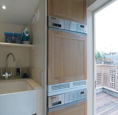 Belgravia contemporary laundry room