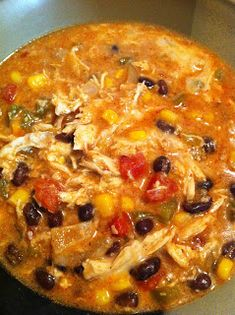 Crock Pot Chicken Enchilada Soup...Mmmm, filled with black beans, corn, tomatoes, peppers & monterey jack cheese!!  Delicious!!