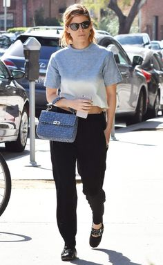 Kate Mara in a grey short-sleeve top and black pants - click through for more spring outfit ideas