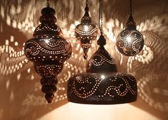 Using age-old metal working techniques, each of these Moroccan lights is hand-hammered in strikingly beautiful patterns by skilled artisans. You will admire the fine handiwork when unlit and the gorgeous ambient light and shadows cast when lit.  It would be absolutely stunning over a dining table or a kitchen island! http://qoo.ly/be4tb