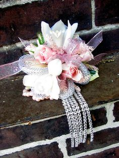 Pink and white wrist corsage. Designer: Worcester florists - Sprout