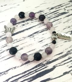 Diffuser bracelet that combines the benefits of healing crystals (Rose Quartz, Fluorite and Black Lava) aromatherapy with essential oils (of your choice that you can add), along with unique charms that have special symbolic meanings. Each one comes with a description of each bead and what they are commonly used for and a description of the charms and their symbolic meanings