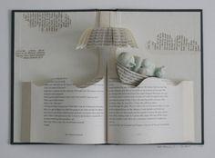 Altered Book art. Sleeper on waves book sculpture.