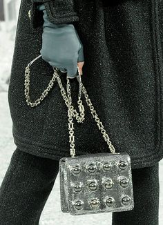 CHANEL - what we love about this bag is it highlights several Fall trends in accessories - Silver and embellishment - almost like a piece of jewelry.