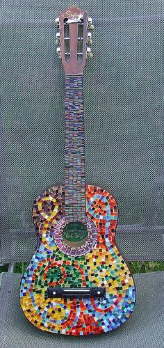 Mosaic guitar by glowing sunsets