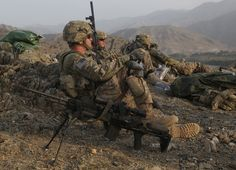 U.S. Army soldiers assigned to Bravo Company, 1st Battalion, 327th Infantry Regiment, 101st Airborne Division, take up overwatch positions at objective point cobra during Operation Shaheen XIII, near Bati Kot, Nangahar province, Afghanistan, June 27, 2013.