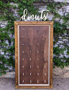 Donut Wall Ideas  Large vintage gold frame with dark stain wood insert. Gold laser cut Donuts sign