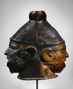 Ejagham Janus Helmet Mask, Cross River Region, Nigeria and Cameroon consisting of a wood carcass covered in Red Duiker (Cephalophus natalensis) hide, with attachments of Human (Homo sapiens) hair. Height: 16 3/4 in (42.5 cm)