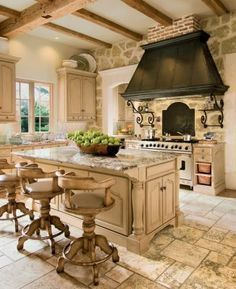 THIS COUNTRY KITCHENS STYLE IS VERSITALE & CAN B COUNTRY FRENCH,MEDITERRANIAN,ITALIAN,OLD WORLD OR TUSCAN STYLE & DECOR. THERES MANY SPECIAL FEATURES IN THIS SPACE,CUSTOM CABINETS AND ISLAND,TOP END APPLIANCES,PRETTY KITCHEN FLOOR TILES, THE BEAUTIFUL CEILING W/ SOLID WOOD BEAMS W/LIGHT FINISH,WHICH ISNT THE NORM 4 THESE DECOR STYLES,USUALLY THEYRE DARK, THE LIGHT FINISH ON THE CEILING BEAMS R PERFECT FOR THE LIGHT NEUTRAL TONE ON TONE COLOR SCHEME IN THIS BEAUTIFUL KITCHEN..CHERIE