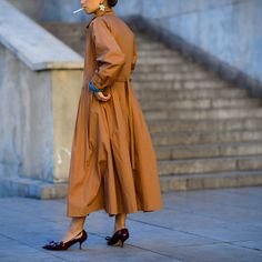 The street style stars of Paris Fashion Week Spring 2016 proved that trench coats are a wardrobe essential, rain or shine. Here, see how Parisians mix up the outerwear trend with belts, layers, and of course, fabulous shoes.