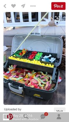 Adorable fishing tackle box candy display for mermaid birthday party