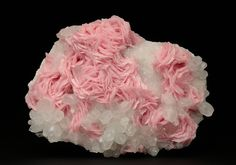 Pink rosettes crystal specimen of Rhodochrosite on Quartz from the Cavnic mining area in Romania