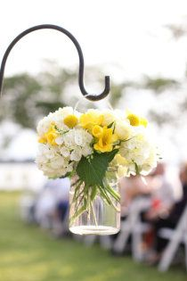 :  ) A simple jar filled with flowers, hanging from a 'shepherds' hook.'
