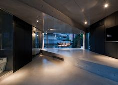 Apartment sYms is a minimalist house located in Tokyo, Japan, designed by Kiyonobu Nakagame Architect & Associates.