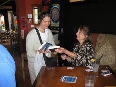 Spallone presents signed books to a guest Chicago River, Book Signing, Simple Way, Book Art, Presents, Sun, Books, Gifts, Libros