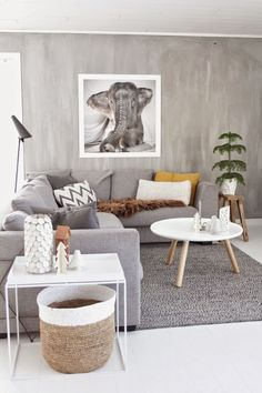 Gray Scandinavian living room. Fur throw on couch and pillows