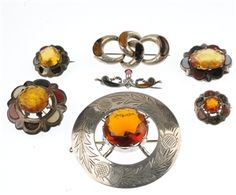 LOT:87 | A selection of seven Scottish silver hardstone brooches...traditional designs estimate 40-60