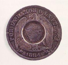 Moneda chilena de un peso de 1884, resellada en Guatemala.