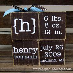 Custom baby blocks: 4x4 wood blocks, paint and vinyl letters. Love it!