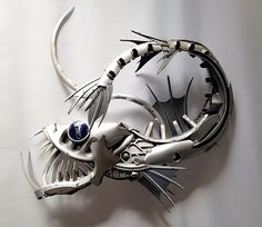 Old Hubcaps Recycled Into Stunning Animal Sculptures
