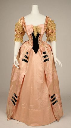 Jacques Doucet, Ball Gown of Light Coral Silk with Gold Lace Trimmings & Black Accents. Paris, 1897.