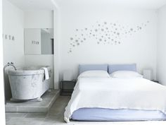 In a couple's 19th-century villa high in the hills on the isle of Capri, even the home's smaller spaces offer an easygoing, contemporary retreat. In the tiny guest room, an installation of porcelain roses is by Art et Floritude. The marble tub is antique, and the floor is paved with travertine tiles.  20 Small Bedroom Decorating Ideas That Will Leave A Major Impression