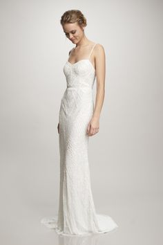 Sleeveless double strap tulle slip beaded with sequins in a corset like motif.