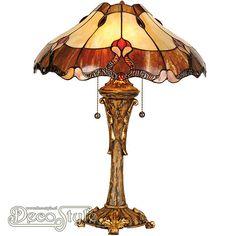Tiffany Tafellamp Xiranda  Een bijzonder mooie tafellamp. Helemaal met de hand gemaakt van echt Tiffanyglas. Dit originele glas zorgt voor de warme uitstraling. De voet is vervaardigd van brons. Met 2x grote fitting (E27). Met schakelaar aan de kap. Afmetingen: Hoogte: 35 cm Diameter Kap: 40 cm