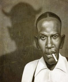 The great bluesman Robert Johnson who according to legend sold his soul to the Devil at a crossroads. By Mark Hammermeister.