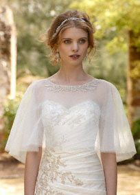 The perfect coverage option for the classic vintage bride!  Tulle cape features stunning detailed neckline.  Available in Ivory and White.  Shown on Bridal Gown Style WG3477.  Imported. Dry clean.