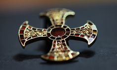 The gold cross found in the grave of the young Anglo-Saxon woman. Photograph: Cambridge University