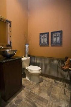 Corrugated tin wainscoting on bottom of western bathroom wall. Want to use this wainscoting in the home. Diy Home, Home Decor, Corrugated Tin, Basement Bathroom, Bathroom Ideas, Bathroom Wall, Bathroom Colors, Cowboy Bathroom, Lodge Bathroom