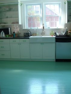Great step-by-step instructions for how one blogger painted her kitchen floor for under $50 | From Effortless Style blog