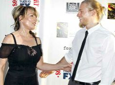 Actors Katey Sagal and Charlie Hunnam, stars of FX cable channel series Sons of Anarchy, arrive at the premiere screening of season three in Hollywood, California.