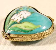 I collect little heart boxes, but I don't have this one!  Very pretty!  Lily of the Valley is the flower for May, which is the birth month of my mom, brother, and son!  <3