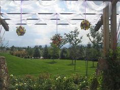 Flower Balls Added To An Arbor @ Brookside Gardens Berthoud, CO   Design By Beth Parker www.earlesflowers.com  Earle's Loveland Floral and Gifts   1421 N. Denver Ave Loveland, CO 80538  970.667.7550