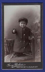 Vintage cabinet card of German boy in large dress robe