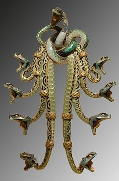 Rene Lalique Gold and enamel pectoral. Love Lalique + Hate Snakes = Conflicted.