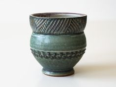This listing is for one handmade stoneware cup. The exterior is glazed in a beautiful matte-turquoise hue with some areas of crackle. Before the firing