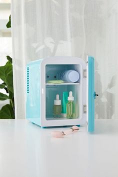 The Beauty Spy Mini Beauty Refrigerator - Blue at Urban Outfitters Tiny Fridge, Refrigerator, Mini Washing Machine, Voltage Converter, Facial Steamer, Glass Vanity, Beauty Sponge, Brush Cleaner, Makeup Yourself