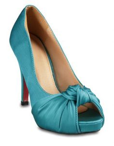 These Linx Knotted Peep Toe Heels are designed for thegirl who does not sacrifice comfort for style.Bold with their teal, satin uppers, peep toes andknot detailing, these heels slip on easily andwill add a pop of colour to any ensemble. Watchheads turn and don these stunners with a sexy,little black dress and bold red lips.