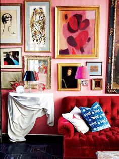 "7 Design ""Mistakes"" That Are Actually Totally Chic//Pink living room with red tufted sofa and gallery wall"