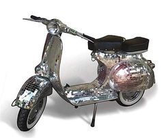 Who would have thought to bling out a Vespa? lol