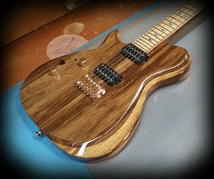 Kiesel Guitars Carvin Guitars  SCB6 left handed ( in black limba top with a black limba body, zebrawood fretboard