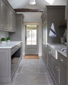This door to this utility room opens onto the garden behind, so with pets and children hardwearing natural limestone flooring is essential. Boot Room, Kitchen Projects, Room Design, House, Home, Laundry Room Inspiration, Limestone Flooring, Built In Dog Bed, Utility Room Designs