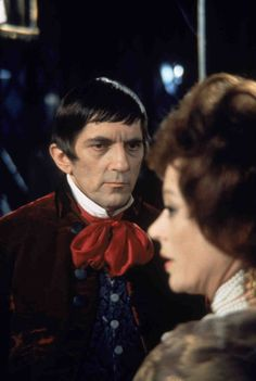 Medium shot of Jonathan Frid as Barnabas Collins looking at Grayson Hall as Dr. Julia Hoffman, in profile in foreground.