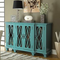 Accent Cabinets Large Teal Cabinet with 4 Glass Doors by Coaster  Item #950245